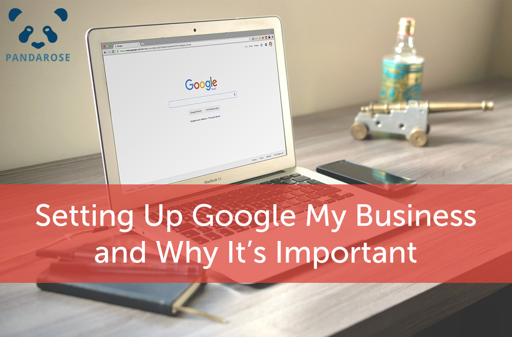 setting up google my business and why it's important; macbook on a desk with a toy cannon, bottle, notebook