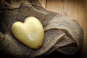 heart-shaped potato on a pile of burlap